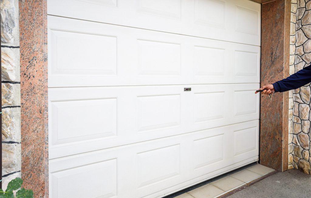 Person-Pointing-Remote-Toward-Garage-Door