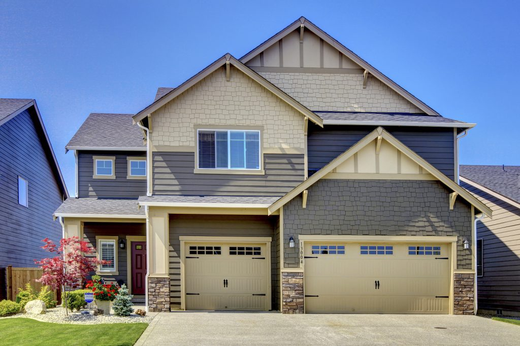 Two-Story-Suburban-Home-Light-Yellow-and-Gray-with-Two-Garage-Doors